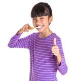Young Girl Brushing Teeth VIII Royalty Free Stock Photos