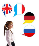 Young girl and bubbles with countries flags. Stock Images
