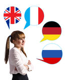 Young girl and bubbles with countries flags. Young girl surrounded by dialogue bubbles with countries flags. Germany,  Britain, Russia, Czech. Learning of Stock Image