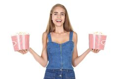 Young girl with buckets of popcorn