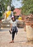 Young girl and buddha at Wat Yai Chai Mongkol Temple. Ayutthaya Royalty Free Stock Photos