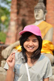 Young girl and buddha at Wat Yai Chai Mongkol Temple Stock Image