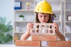 The young girl building with construction bricks. Young girl building with construction bricks royalty free stock images