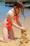 Young Girl Building Sand Castle Royalty Free Stock Photo