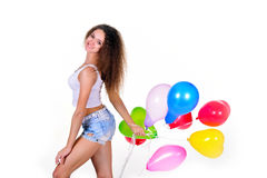 Young girl with a bunch of heart-shaped balloons Royalty Free Stock Photo