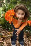 Young girl with a bunch of lilies Stock Images
