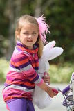 Young girl with bunny doll Stock Images