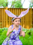 Young Girl in Bunny Ears in a Garden royalty free stock photos