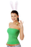 Young girl with bunny ears holding golden egg Royalty Free Stock Image