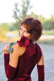 Young girl in a burgundy dress Royalty Free Stock Photography