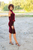 Young girl in a burgundy dress Royalty Free Stock Images