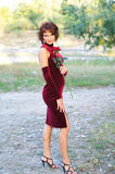 Young girl in a burgundy dress Stock Photo