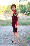 Young girl in a burgundy dress Stock Photography
