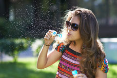 Young girl and bursting of bubble royalty free stock photo
