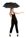 Young girl in a business suit and carrying an umbrella Stock Photo
