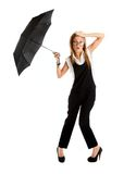Young girl in a business suit and carrying an umbrella Stock Image