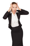 Young girl in a business suit clutching his head Royalty Free Stock Images