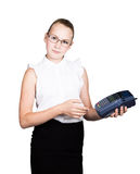 Young girl in a business suit, offers e-card to pay for purchases Royalty Free Stock Image