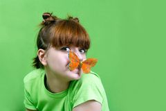 Young girl  with  butterfly. On green background Royalty Free Stock Photography