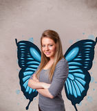 Young girl with butterfly blue illustration on the back. Cute young girl with butterfly blue illustration on the back royalty free stock images