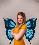 Young girl with butterfly blue illustration on the back Stock Images