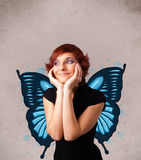 Young girl with butterfly blue illustration on the back Stock Image