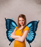 Young girl with butterfly blue illustration on the back Stock Photography