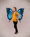 Young girl with butterfly blue illustration on the back. Cute young girl with butterfly blue illustration on the back stock image