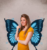 Young girl with butterfly blue illustration on the back. Cute young girl with butterfly blue illustration on the back stock photography