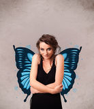 Young girl with butterfly blue illustration on the back. Cute young girl with butterfly blue illustration on the back stock images