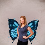 Young girl with butterfly blue illustration on the back. Cute young girl with butterfly blue illustration on the back stock photos