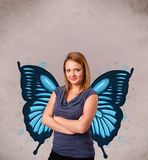 Young girl with butterfly blue illustration on the back. Cute young girl with butterfly blue illustration on the back royalty free stock photography