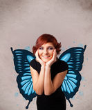 Young girl with butterfly blue illustration on the back Royalty Free Stock Photography