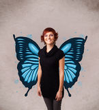 Young girl with butterfly blue illustration on the back. Cute young girl with butterfly blue illustration on the back royalty free stock photos