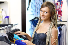 Young Girl Buying Clothes Royalty Free Stock Photos