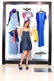 Young Girl Buying Clothes Royalty Free Stock Photo