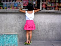 Young girl buying at a store Royalty Free Stock Image