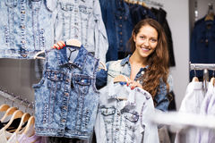 Young girl buying vest in a store Royalty Free Stock Image
