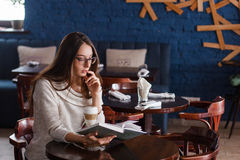 Young girl in the cafe, book, reading, coffee. stock photo