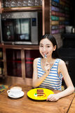 Young girl at a cafe drinking coffee Royalty Free Stock Photography