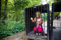 Young girl in cage Royalty Free Stock Images