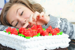 Young girl with cake Stock Photography