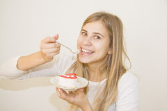 Young girl with a cake slice on a plate Stock Photography