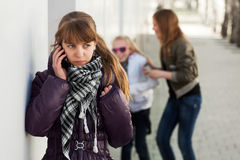 Young girl calling on the cell phone Stock Images