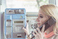 Young girl calling by phone Stock Photography