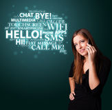 Young girl calling by phone with word cloud Stock Photo
