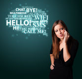 Young girl calling by phone with word cloud Royalty Free Stock Image