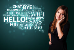 Young girl calling by phone with word cloud Royalty Free Stock Photography