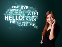 Young girl calling by phone with word cloud Stock Photography