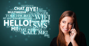 Young girl calling by phone with word cloud Stock Photos